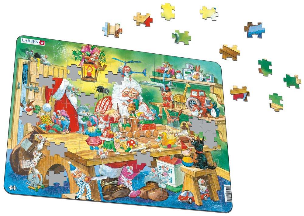 Mikuláš ( Santa Claus ) sedí za stolom, vyrába a tvorí vianočné darčeky, hračky pre deti – Obrázkové puzzle